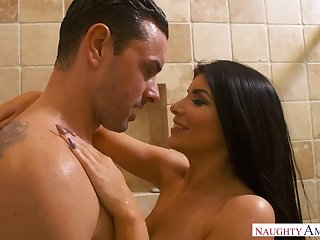Romi Rain is a curvy black-haired nail nymph who loves to rail rock rock-hard spunk-pumps