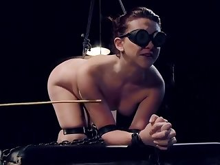 Brunette Mandy Muse is acting in bondage porn scene