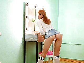 Svelte naturally shaped redhead Marta Lovely is so into teasing her wet pussy