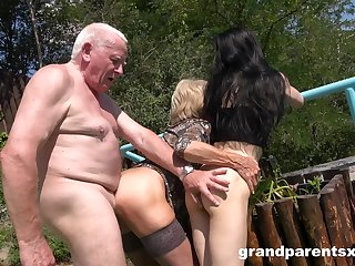Old man rams mature wife and their niece in outdoor threesome