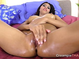Thai street whore oiled up and ready for a creampie
