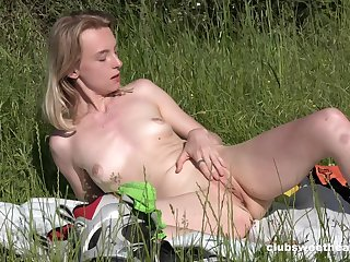 Solo hottie Candy Teen loves rubbing her tight pussy outdoors