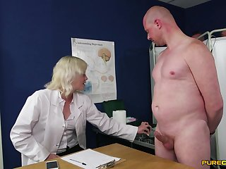 First time this clothed female doctor plays with her patient's dick