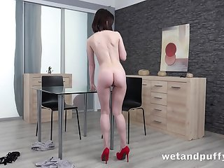 Sexy long legged babe Sara Bell is toying her pretty pink pussy